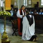 The Rev'd Canon Paul Scott kneels before the Right Rev'd Frank White, Acting Bishop of Newcastle