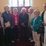 Some of the congregation at Denwick Chapel, and the Vicar, the Rev'd Canon Paul Scott