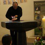 The Rev'd Paul Scott baptises a doll in church